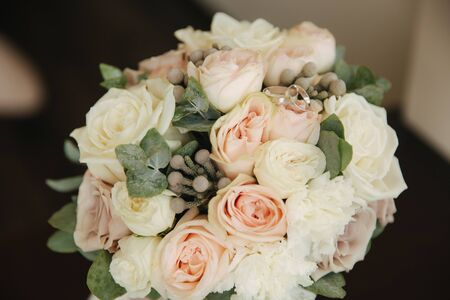 White gold rings on wedding bouquet. flowers