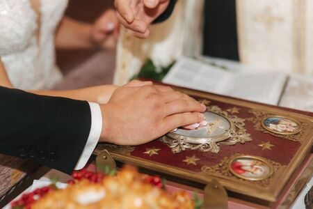 Hands of male and female on Bible in the church 写真素材