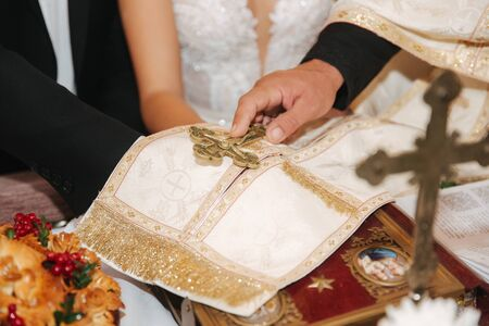 Hands of male and female on Bible in the church Stock Photo
