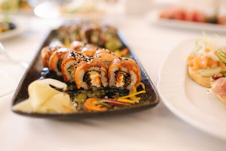 Philadelphia roll sushi with eel fish on the table in the restaurant. Asian food. Banquet concapt