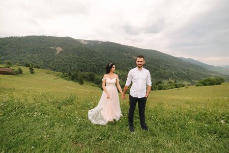 Beautiful wedding couple in Carpathian mountains. Handsome man with attractive woman