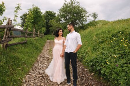 Lovestory of beautiful couple in the mountains, Handsome bearded man with beautiful and charming woman