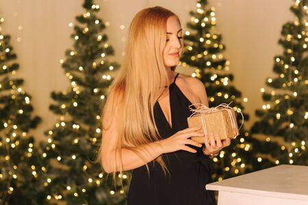 Elegant woman hold present in hands. Christmas mood