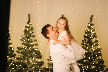 Dad play with his cute little daughter on holiday. Chrisrmas mood Stock Photo