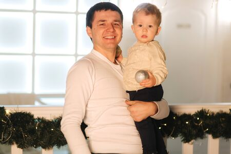Happy father with little son on hands. Winter holiday Stock Photo