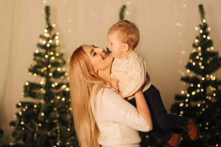 Mom play with her cute little son on holiday. Chrisrmas mood