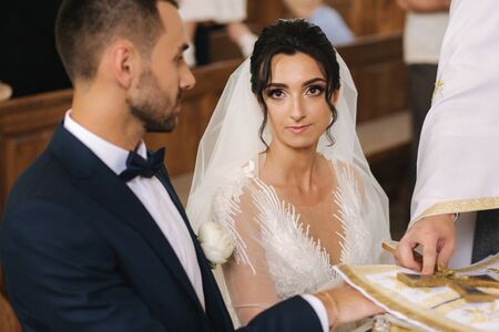 Groom and bride on their wedding in the church