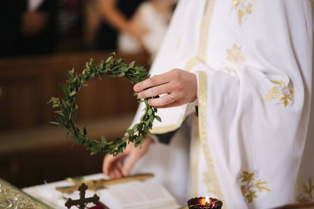 Close up hands of priest in the church on wedding