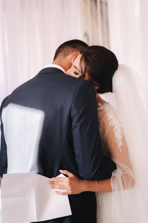 Groom and bride read their wedding vows. Love each other. Stock Photo