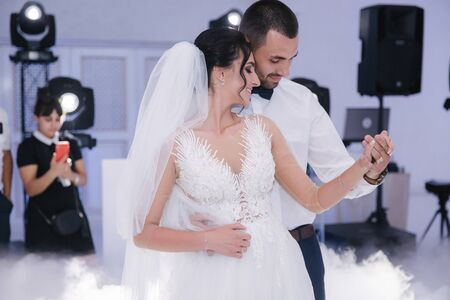 First dance of groom and bride in restaurant. Elegand bride dance with handsome groom Standard-Bild - 133254223