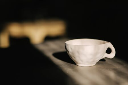 Ceramic cup for tea or coffee on the table. Stockfoto