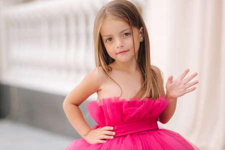 Close up portrait of cute little girl in dress outdoors Reklamní fotografie