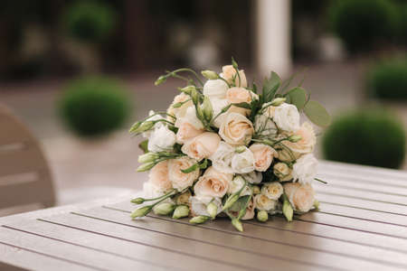 Bouquet of flowers on wooden table outdoors