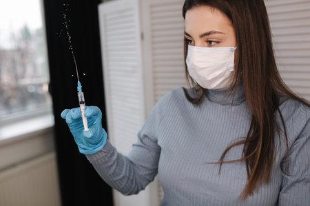 Concept fight against virus covid-19 corona virus. Female holding a syringe with liquid vaccines Stock fotó