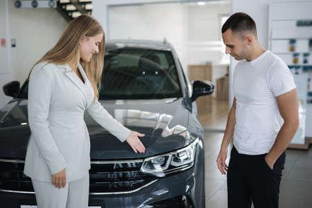 Female sale car for man customer car in car showroom. Good deal