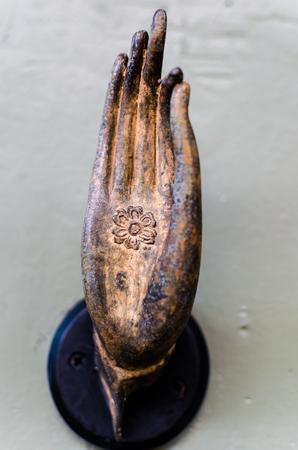 bronzed: A model bronzed hand resembling a hand of Buddha