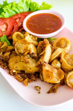 tumeric: Fried squids with garlic and tumeric in Thai recipe. Stock Photo