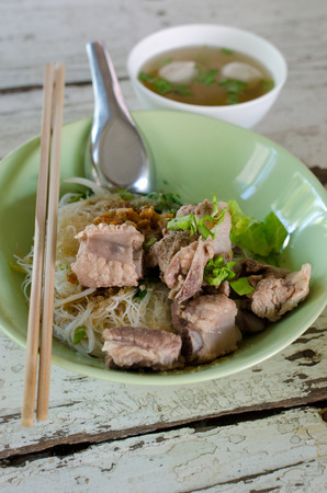 pork ribs: a bowl of noodle soup with pork ribs.