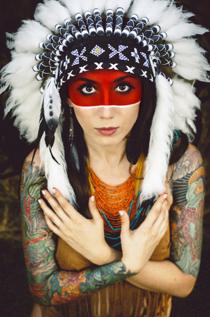 squaw: Indian woman Squaw whit tattoo in a war bonnet