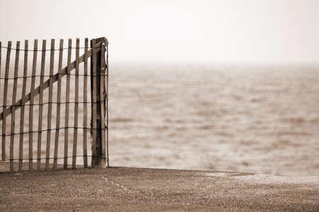 massachussets: Cape Cod Massachussets Wooden Fence on Beach Stock Photo