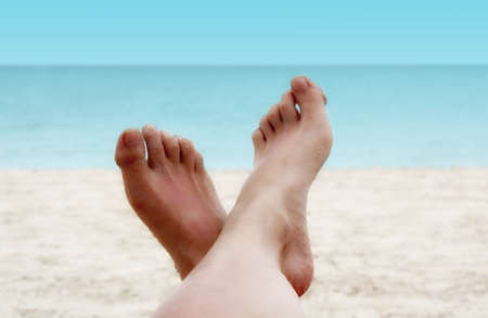touching toes: Sandy Woman Feet on a Tropical Beach