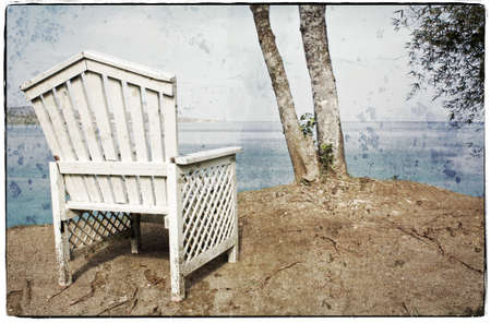 adirondack chair: View on the Ocean on a Vintage Wooden Chair Stock Photo