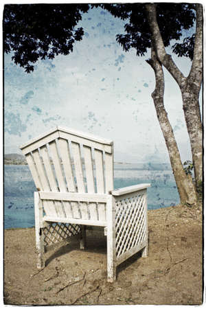 View on the Ocean on a Vintage Wooden Chair photo