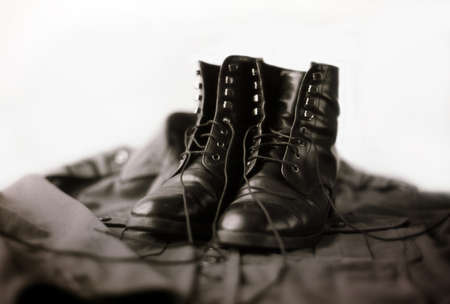Leather Black Army Boots on a Military Vest photo