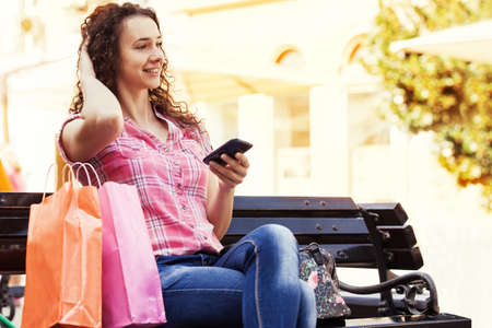 after shopping: Young woman is relaxing after shopping.