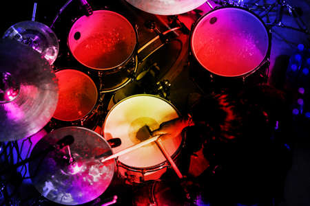 Drummer in the action. Rock music concert.
