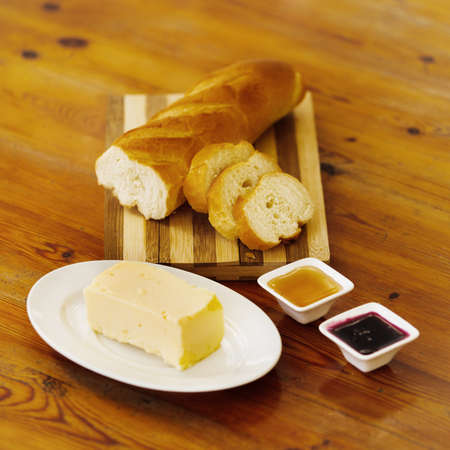 bread and butter: Freash breakfast. Sliced bread, butter, honey and jam. Stock Photo
