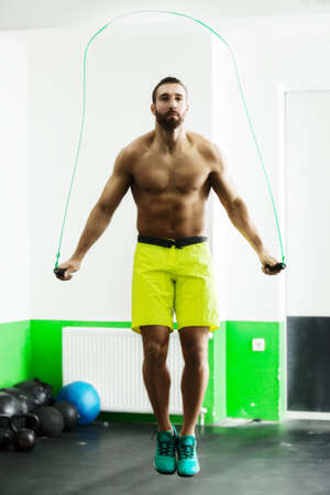 Young fit man using skipping rope. Close up. Stock Photo