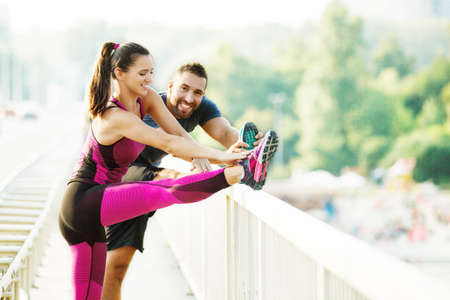 Happy couple exercising outdoors.