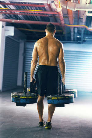 Young fit man pulling up weight. Stock Photo