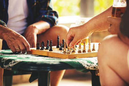 the sixties: Two senior friends playing chess. Stock Photo