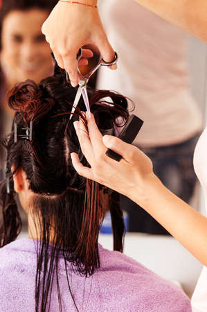 hairdresser: Beautiful young woman at hairdresser. Stock Photo