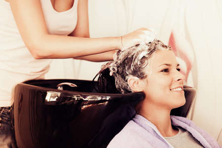 washing hair: Washing hair at hairdresser.