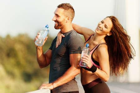 Happy couple exercising on the bridge.