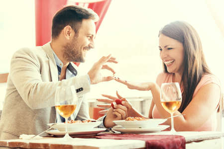 jewlery: Love concept. Happy couple in a restaurant.