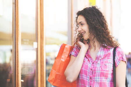 Young woman is relaxing after shopping.