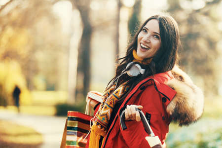 umbrela: Young woman spending time in park.  Stock Photo