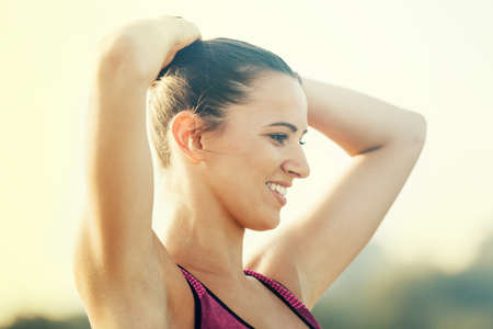 Morning workout. Beautiful young woman exercising outdoors. Living healthy lifestyle.