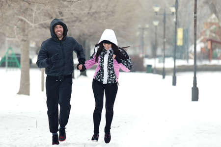 Couple running on cold winter day.