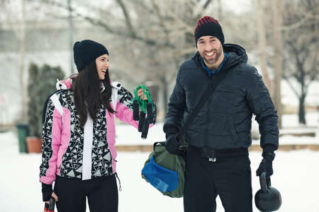 Young couple with equipment ready to exercise outdoors. Stock Photo