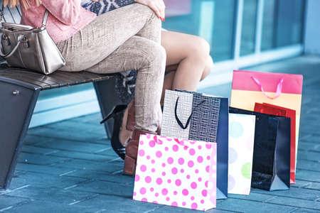 Beautiful women enjoying shopping. Girls having fun.