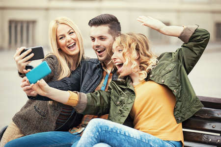 Group of young people having fun in the city. Stock Photo