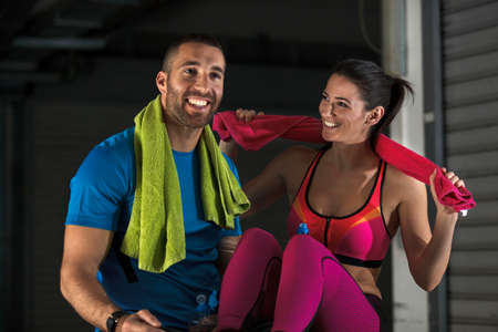 Young athlete couple is relaxing  after training.