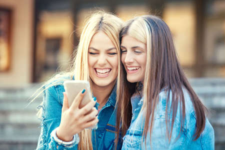 Happy young women having fun in the city. Stock Photo