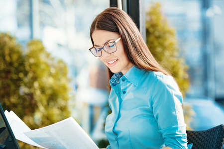 Freelance young businesswoman working outside using lap top. Banco de Imagens