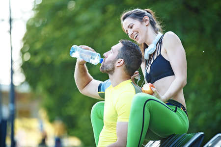 Early morning workout. Happy couple relaxing after working out. Living healthy lifestyle. Stock Photo